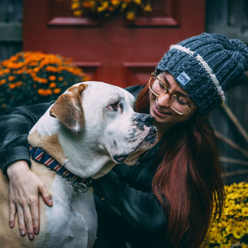 woman and her cute dog looking sad