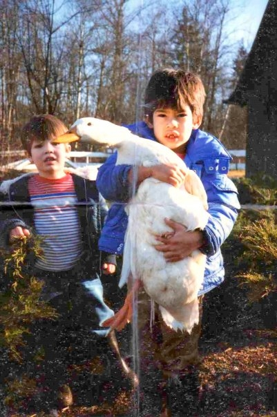 Two boys enjoying a crisp fall afternoon with their giant goose
