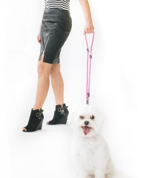 Woman walking dog with adjustable eco-leather leash