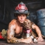 """Dustin Ford """"Mr. May"""" of North Charleston Fire Department with rescue model Cailtyn"""